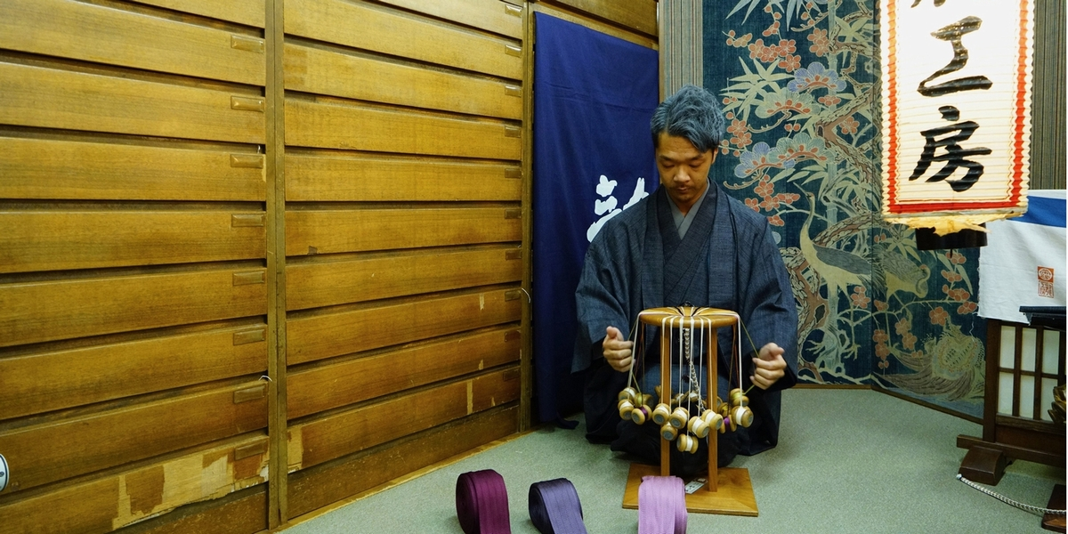 """The<i>kumihimo</i>has always been highly appreciated, it symbolizes connection and respect, as well as """"usefulness"""" and """"beauty"""". The deep traditional beauty of Japan is visible in the braid of """"Ryukobo"""" and conveys this imaginary."""